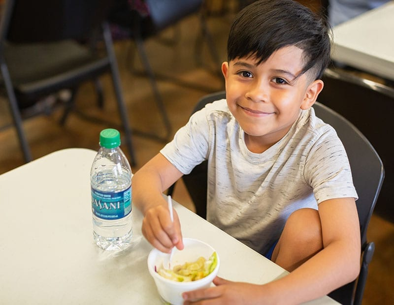 Child eating at Child Nutrition Programs